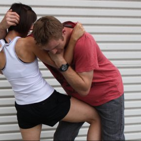 Self defence woman female girl hair hold groin knee